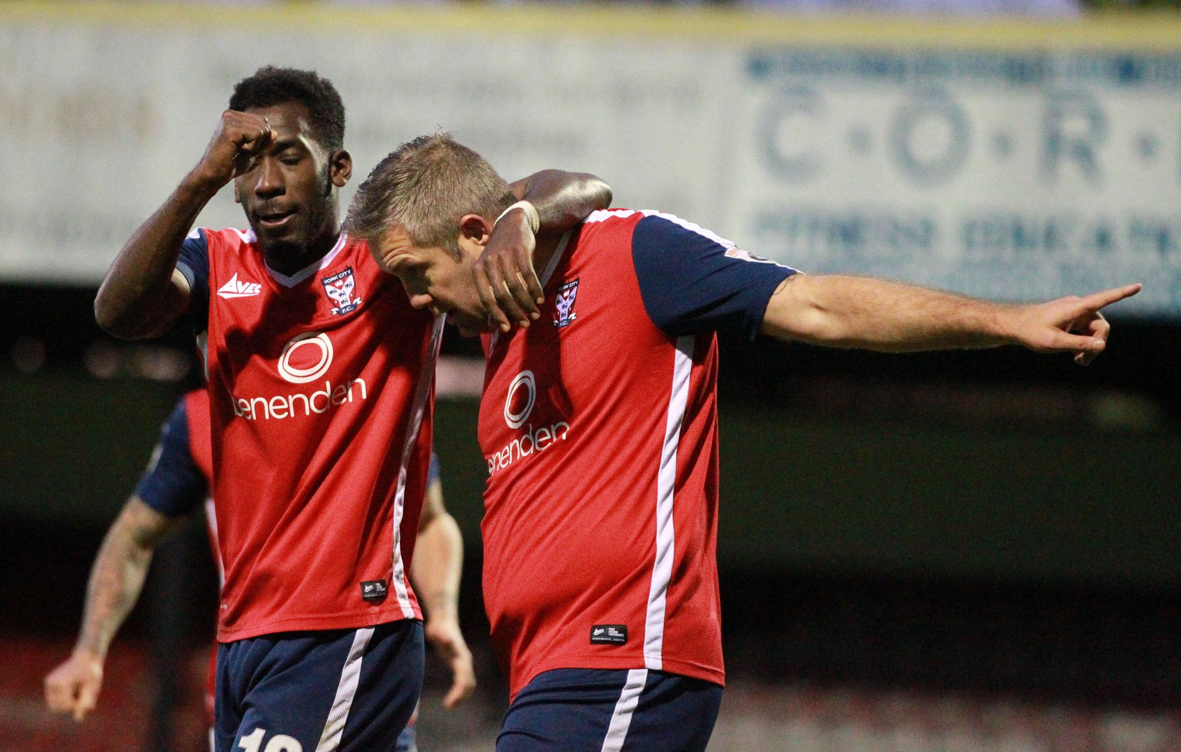 MAKING HIS POINT: Jon Parkin celebrates with Amari Morgan-Smith after converting his first penalty against Coalville. Picture: Gordon Clayton