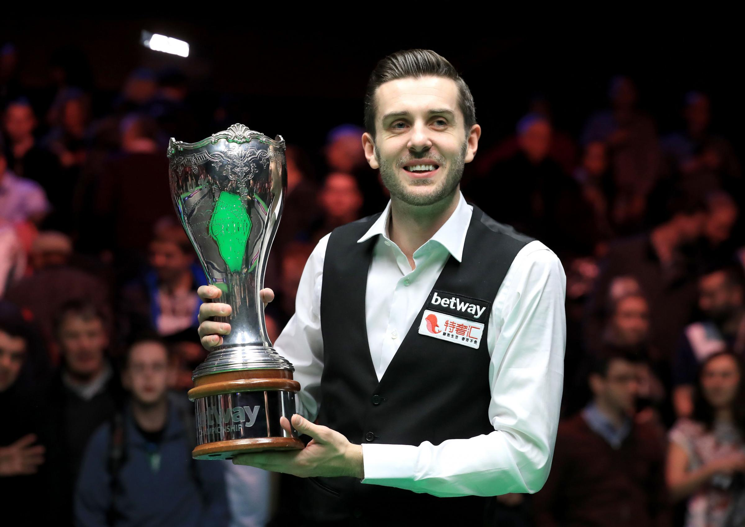 Mark Selby celebrates with the Betway UK Championship trophy after last year's victory over Ronnie O'Sullivan at the York Barbican