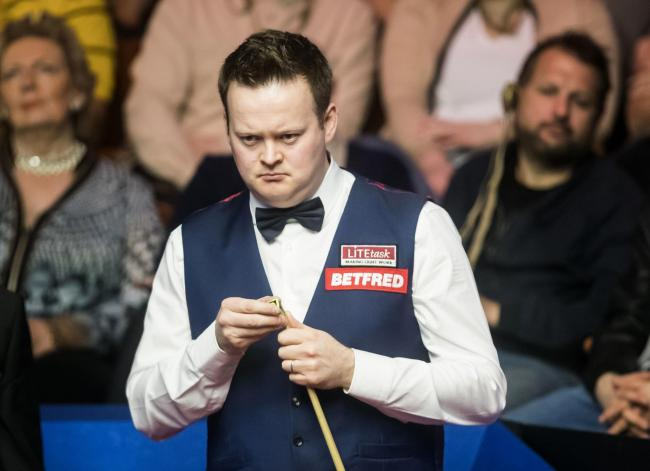 Shaun Murphy in action against Yan Bingtao on day two of the Betfred Snooker World Championships at the Crucible Theatre, Sheffield. PRESS ASSOCIATION Photo..Picture date: Sunday April 16, 2017. See PA story SNOOKER World. Photo credit should read: Danny