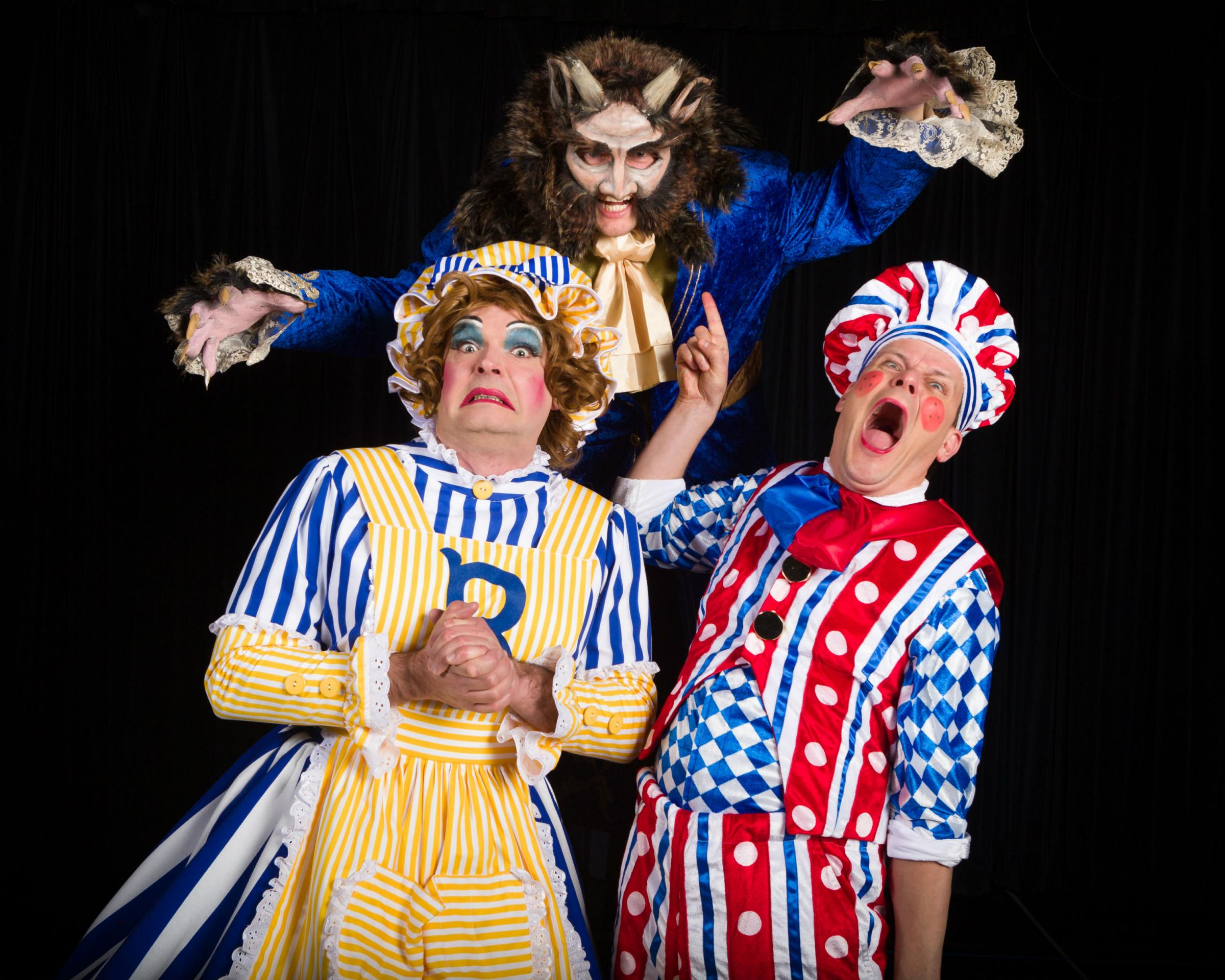 Tom Bainbridge, as The Beast, with Phil Stewart's dame, Pam au Chocolat, and Tim Stedman's Muddles in Harrogate Theatre's pantomime, Beauty And The Beast