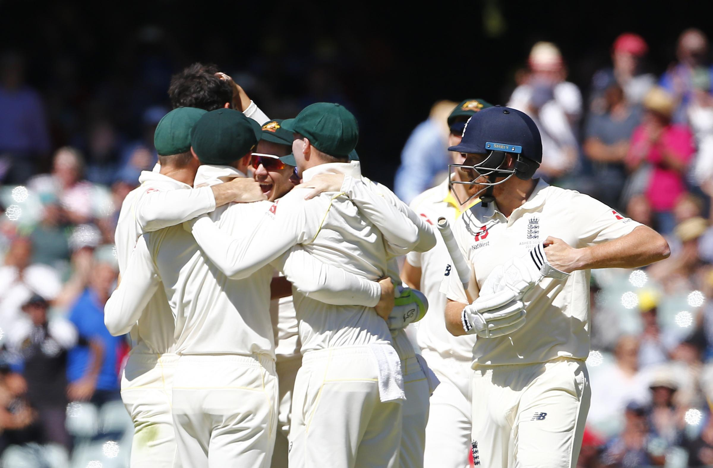 Australia players celebrate the wicket of Jonny Bairstow which clinched victory in the second Test against England at the Adelaide Oval. Picture: Jason O'Brien/PA Wire