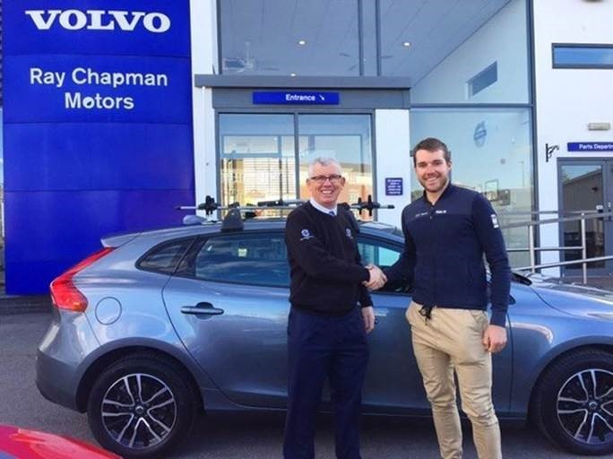 MOTOR POWER: Duncan Chapman of Ray Chapman Motors hands over a vehicle to Brenton Jones.The dealership has provided a sign-written Volvo V40 and accessory bike racks