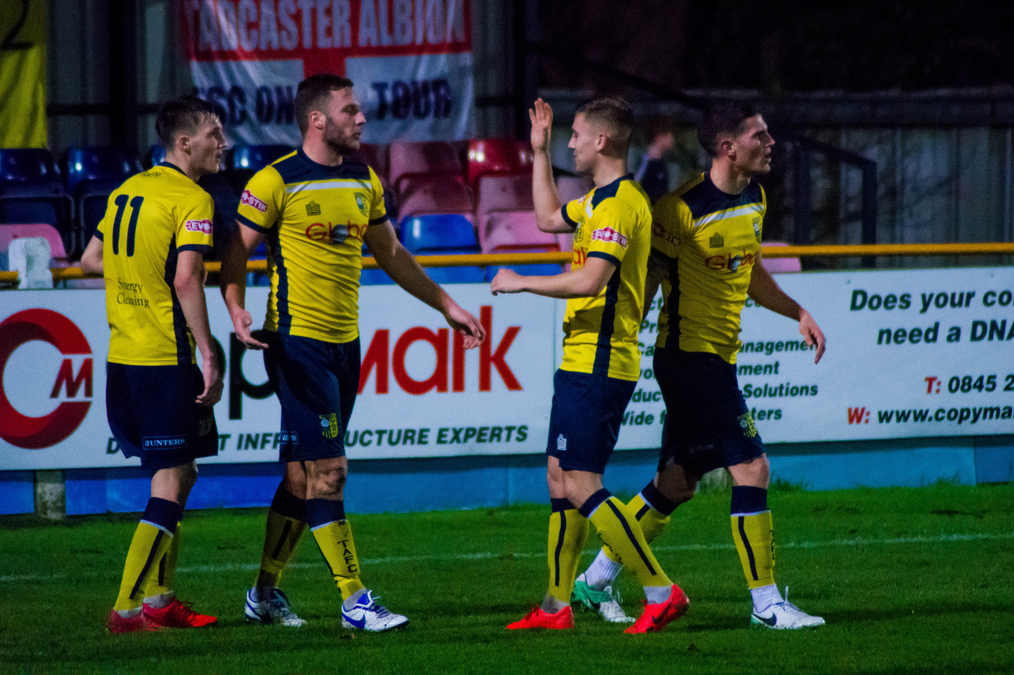 Tadcaster Albion's Aiden Savory is congratulated by his team-mates after scoring during the West Riding County Cup match against Guiseley at the i2i Stadium. Picture: Matthew Appleby