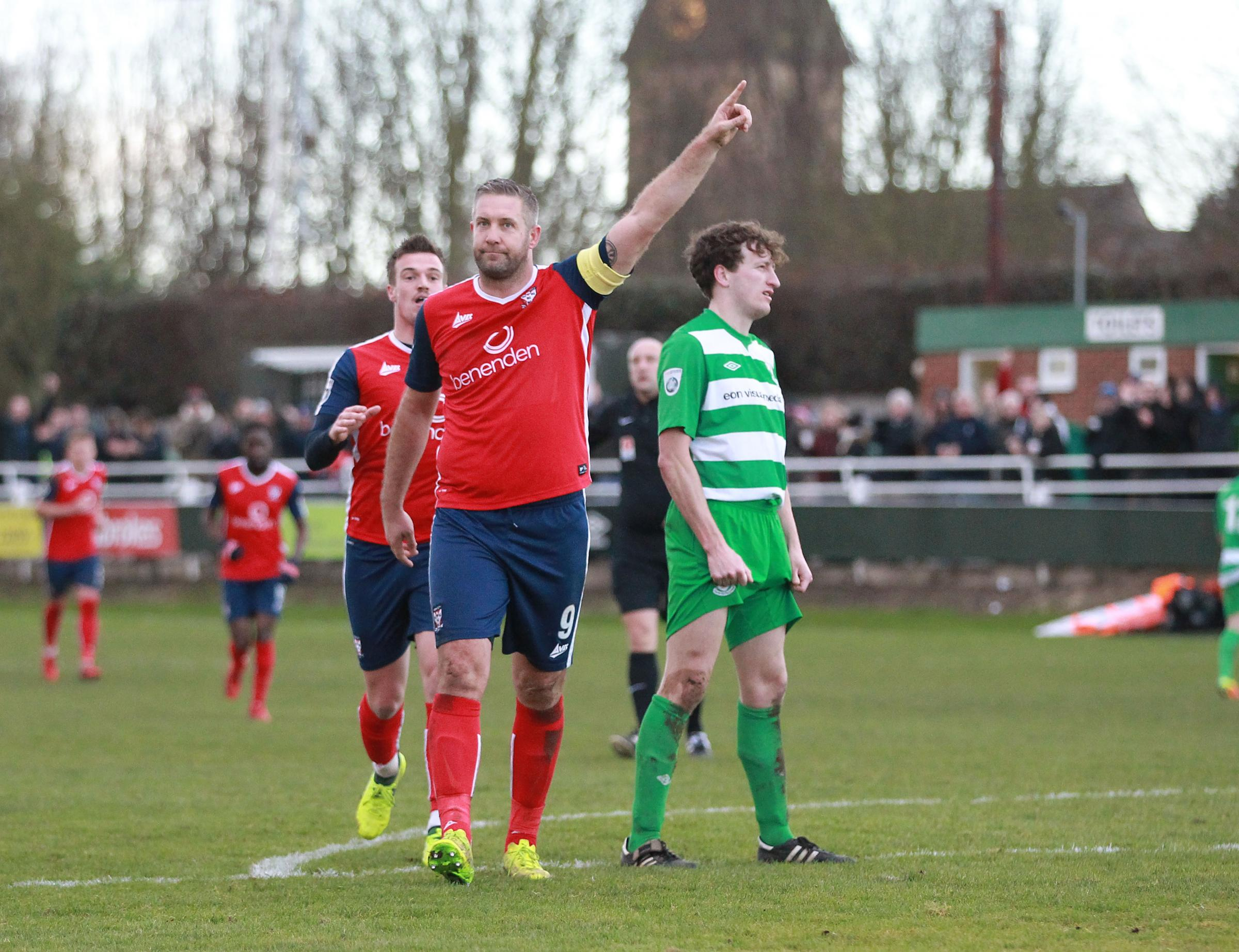 POINTING THE WAY: York City's hat-trick hero Jon Parkin celebrates his third goal at North Ferriby. Picture: Gordon Clayton