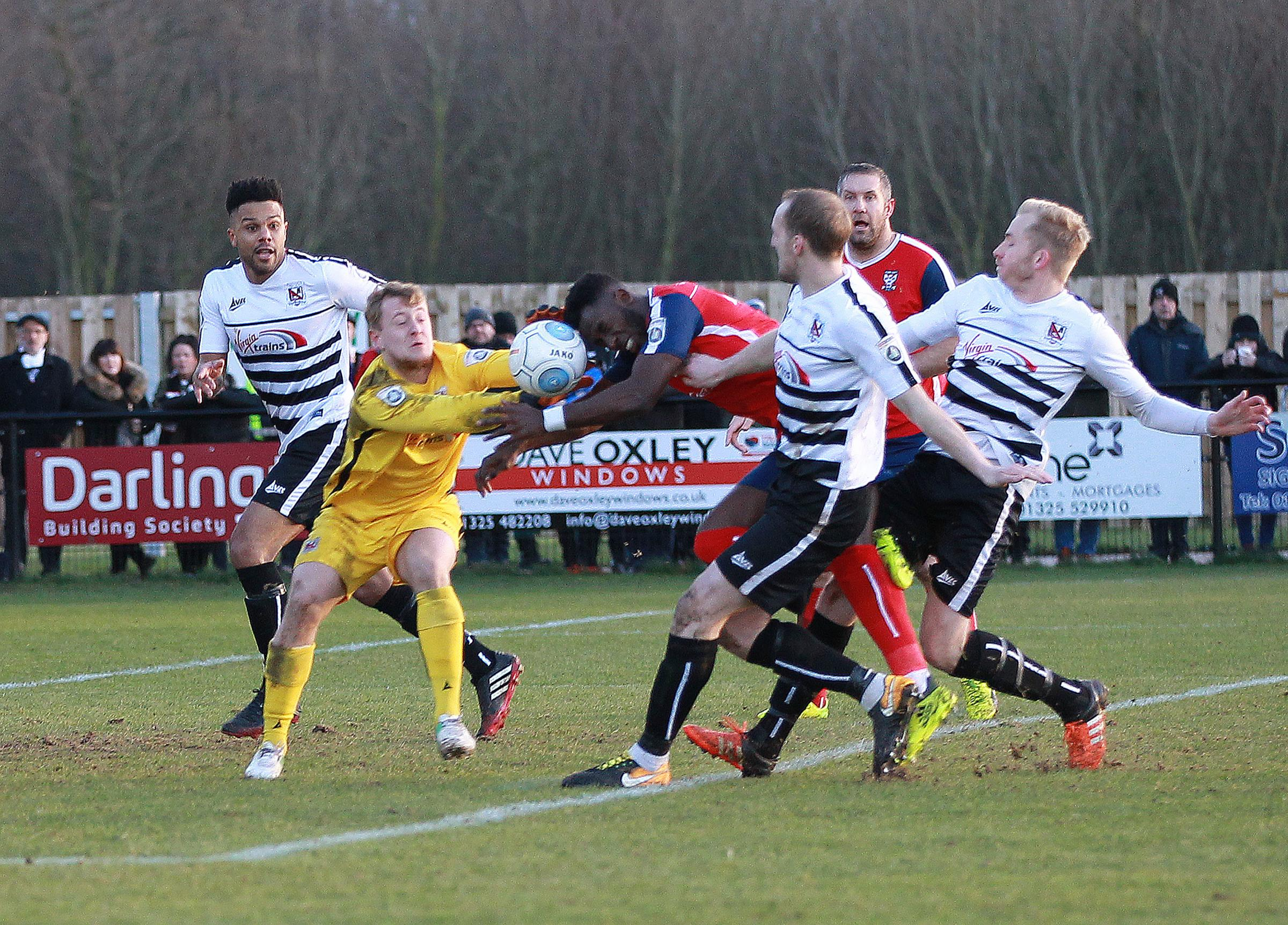 CRUNCH CLASH: York City's Amari Morgan-Smith collides with Darlington keeper James Talbot in the Blackwell Meadows derby contest. Picture: Gordon Clayton