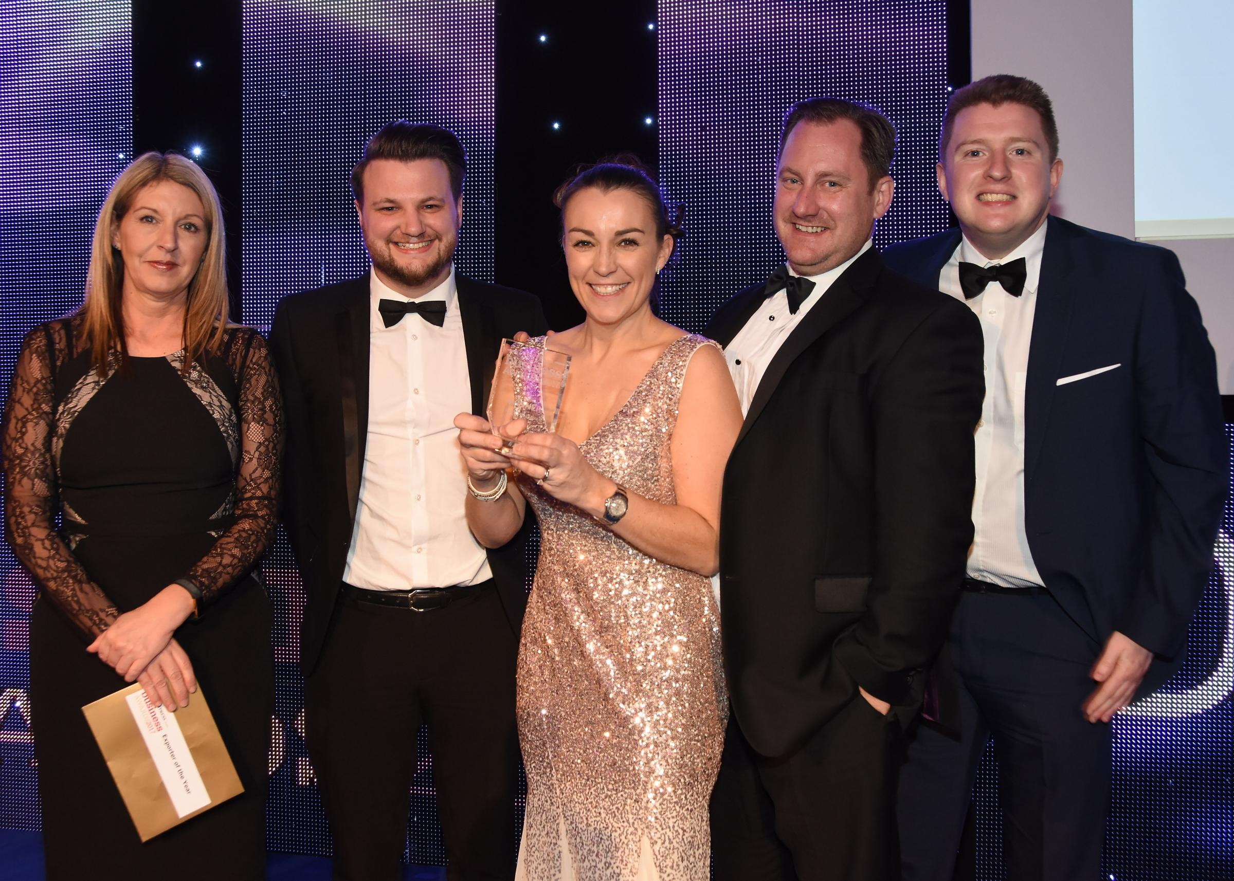 The Press Business Awards 2017. Pictured is Jane Hanson, head of Advertising at The Press presenting the Exporter of the Year award to Damson Global. Picture David Harrison..