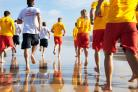 Lifeguards in action Pic by  RNLI/Nigel Millard