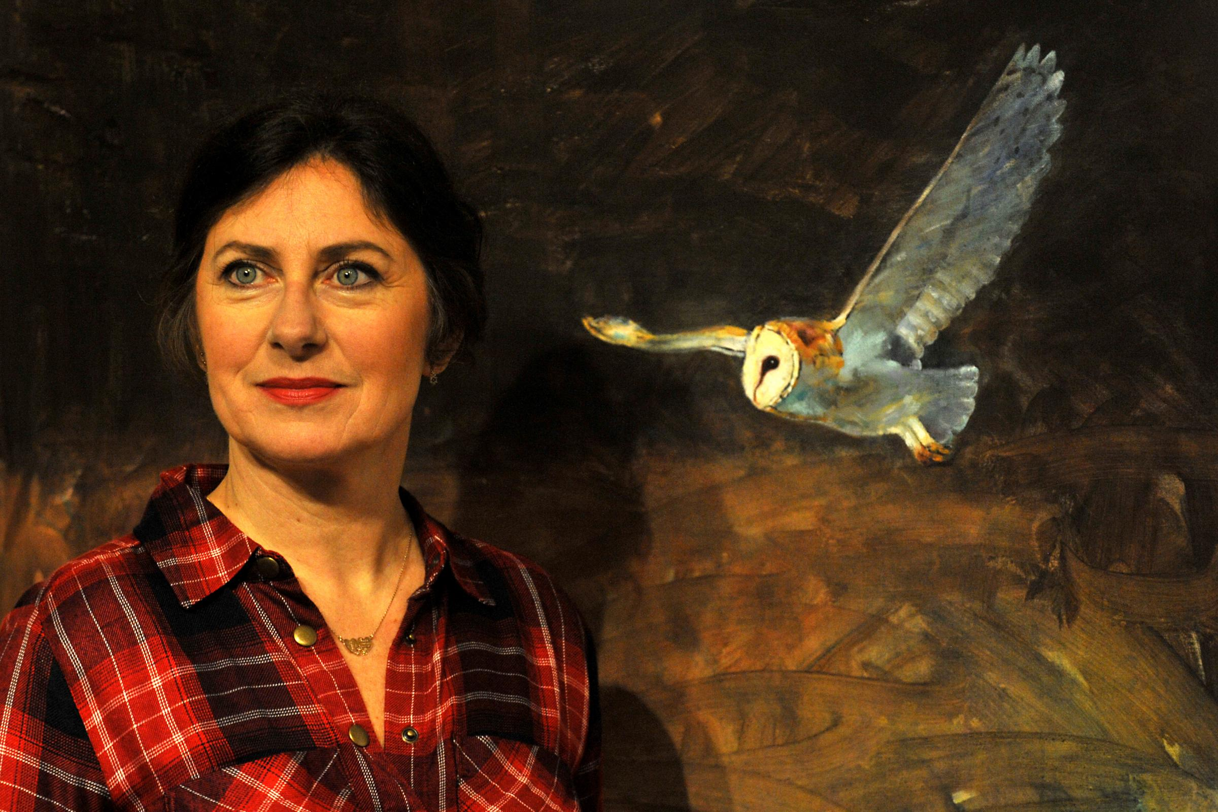 Laura Andrew with her painting Barn Owl At Dusk, 2013, in the Hayloft at Beningbrough Hall. Picture: Matt Clark/National Trust