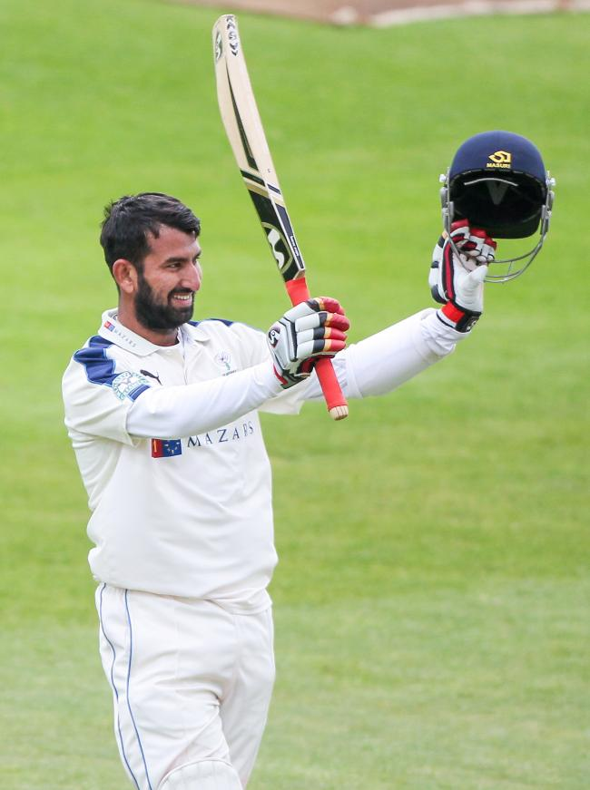 Cheteshwar Pujara celebrates completing a century during his last spell at Yorkshire in 2015 – Picture: Alex Whitehead/SWpix.com