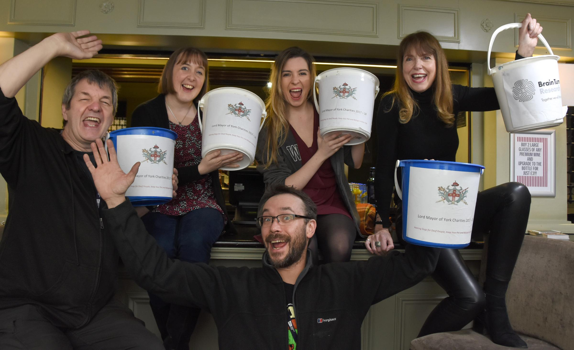 Grand Opera House staff members with their charity collection buckets: Gordon Glover, left, Clare O'Connor, Megan Conway, Celestine Dubruel and, front, Magnus Leslie. Picture: David Harrison/Grand Opera House