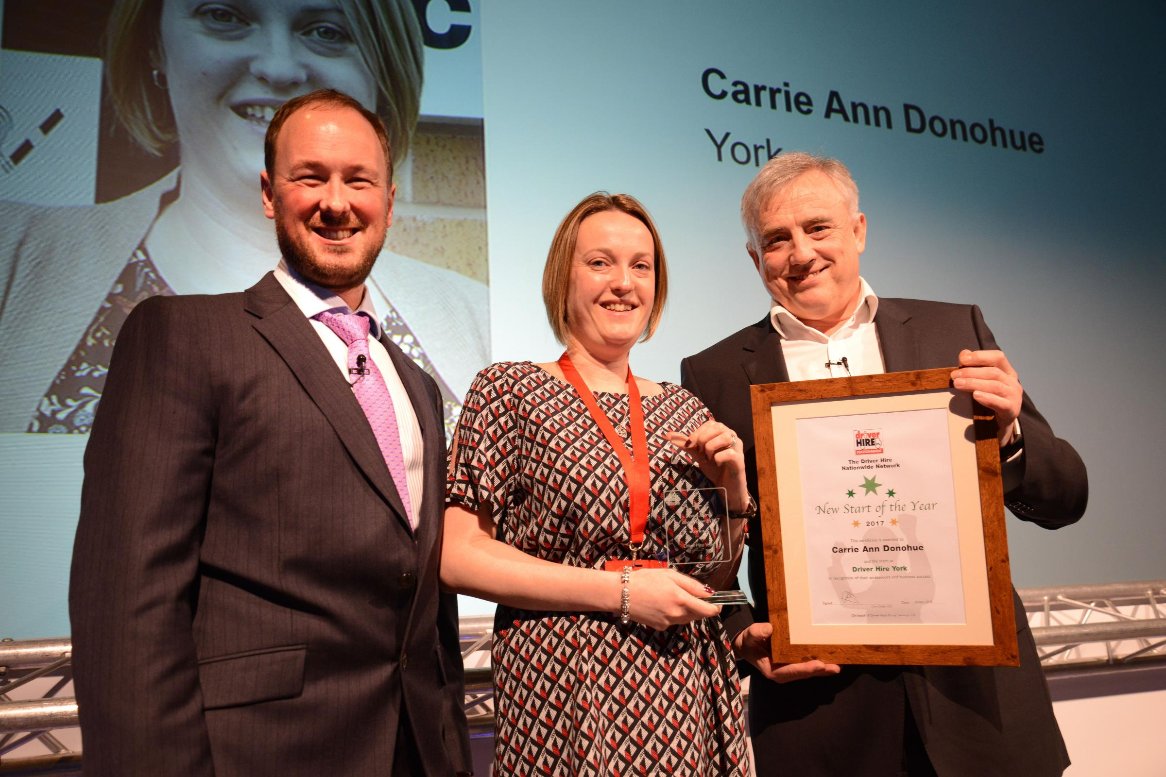 Carrie Ann Donohue collects her award from Jeremy Neale (Driver Hire Managing Director-UK), left and Chris Chidley (Driver Hire Chief Executive), right