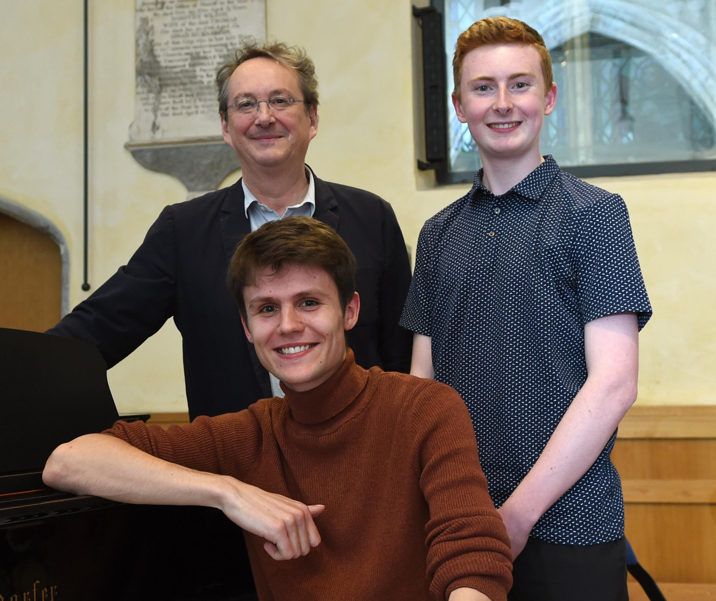 2017 NCEM Young Composers Award winners Dominic Wills (18 and under, back) and Frederick Viner (19 to 25) with Peter Philips, director of the Tallis Scholars