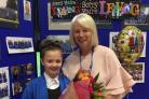 Year 5 pupil Darci Nicholas-Brown presented Mrs Steel with flowers on her retirement from Rufforth Primary