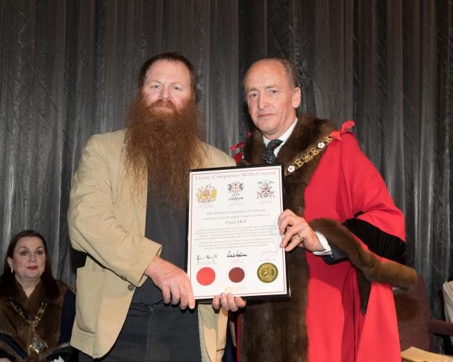 York stonemason Paul Hill, left, receives his award from the Lord Mayor of London, Alderman Charles Bowman.