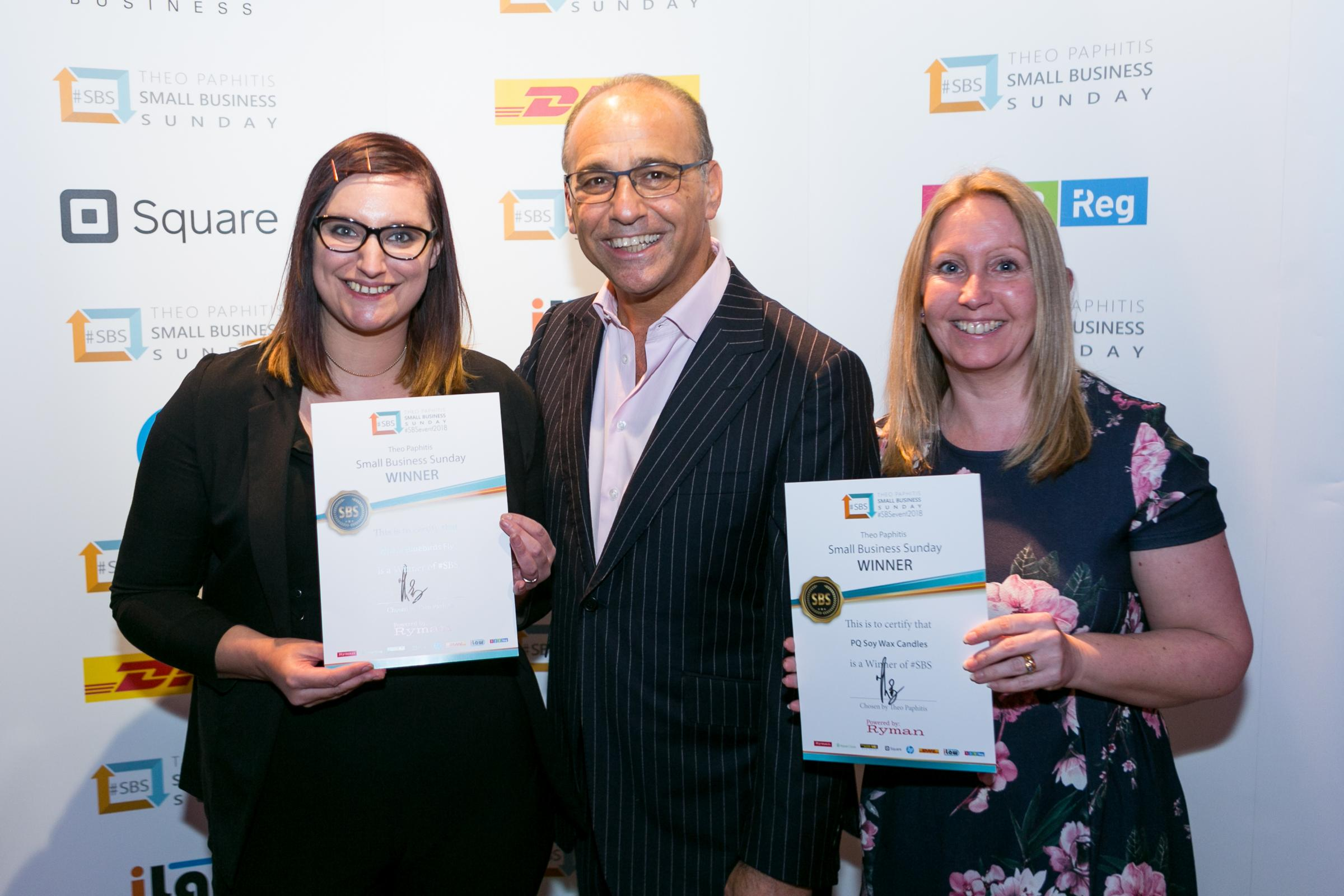 Laura Clarke of Where Bluebirds Fly, left, and Wendy Harris of PQ Soy Wax Candles, right, with Theo Paphitis