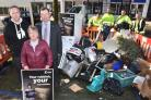 Richard McIlwain (Keep Britain Tidy) and Cllrs Jenny Brooks and Andrew Waller with a pile of fly-tipped waste cleared up from the city that morning by the council.   Picture Frank Dwyer