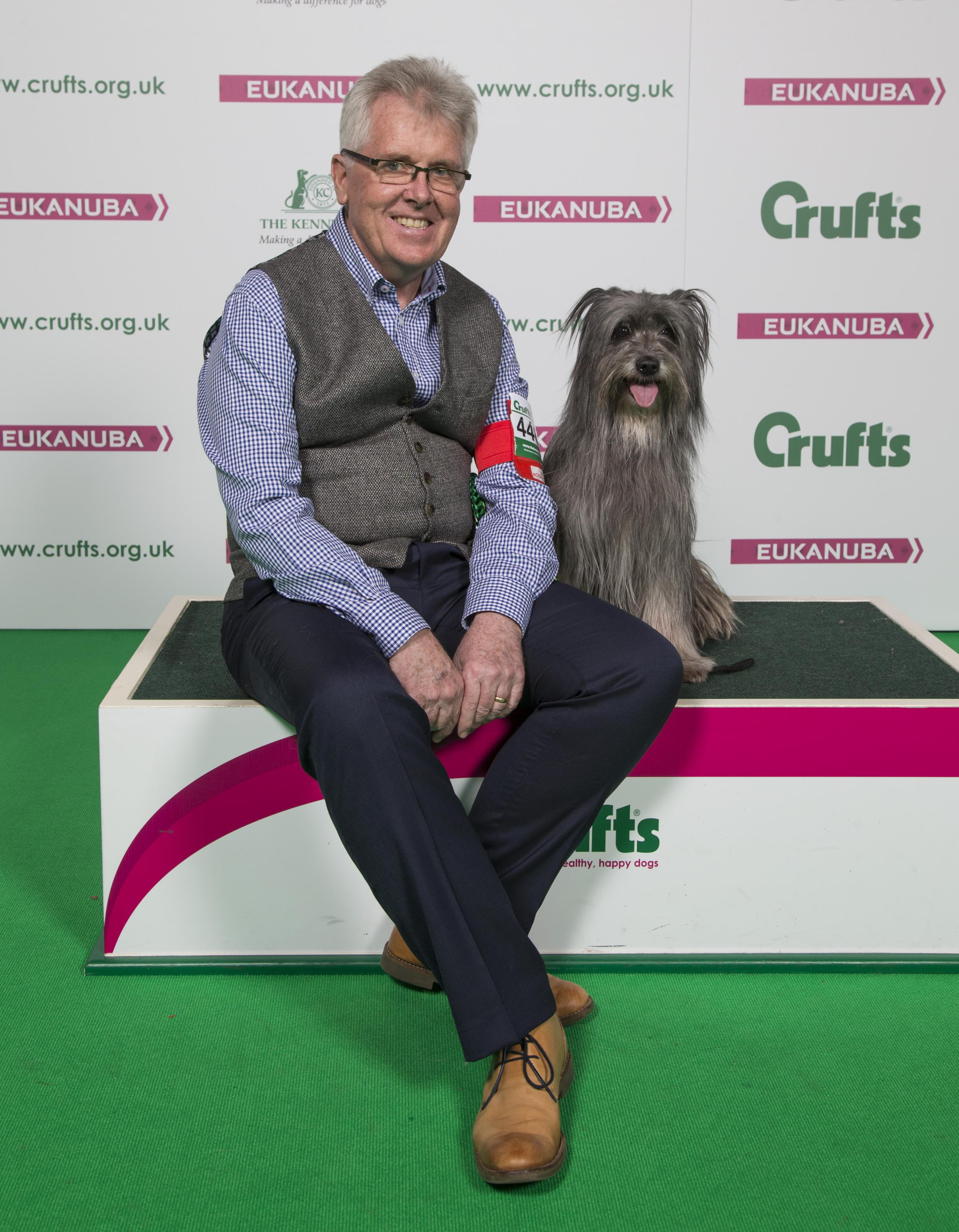Eoin Flint from Pickering with Blue, a long haired Pyrenean Sheepdog, who won best in breed at Crufts Picture: Flick.digital