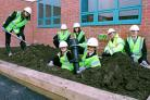 Pupils burying the time capsule at Manor School