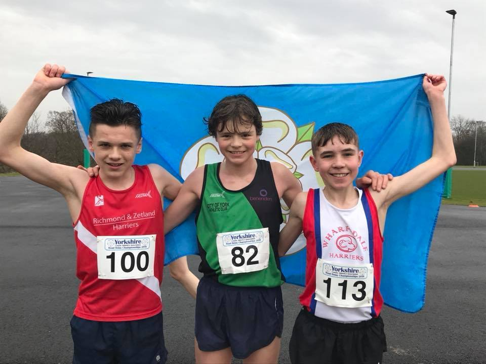 Under-15 boys winner Finnian Hutchinson (82) is flanked by runner-up Sam Smith (113) and third-placed Kyle Rabjohn (100) after his success in the Yorkshire Road Running Championships