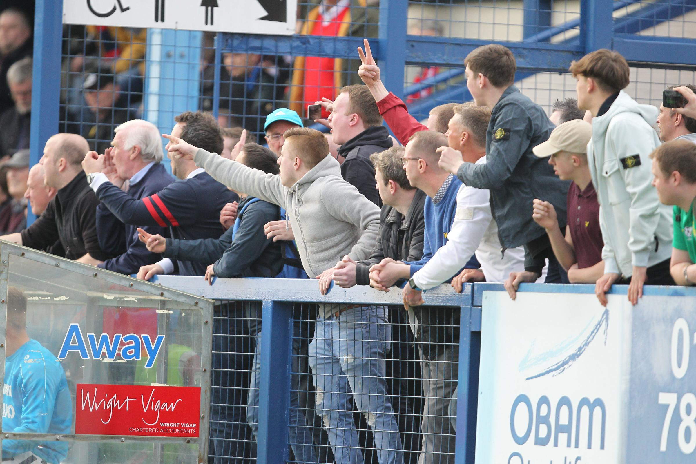 MAKING THEIR POINT: York City fans react angrily to the 1-0 defeat at ten-man Gainsborough Trinity. Picture: Gordon Clayton