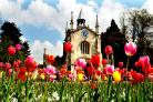 The colourful flower beds and the gatehouse at Bishopthorpe Palace