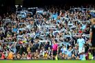 Manchester City boss Pep Guardiola had no concerns about fans celebrating on the pitch (Nigel French/PA)