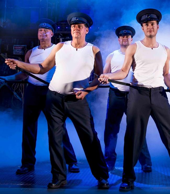 Andrew Dunn, second left, with Louis Emerick, left, Kai Owen and Gary Lucy in The Full Monty. Picture: Matt Crockett