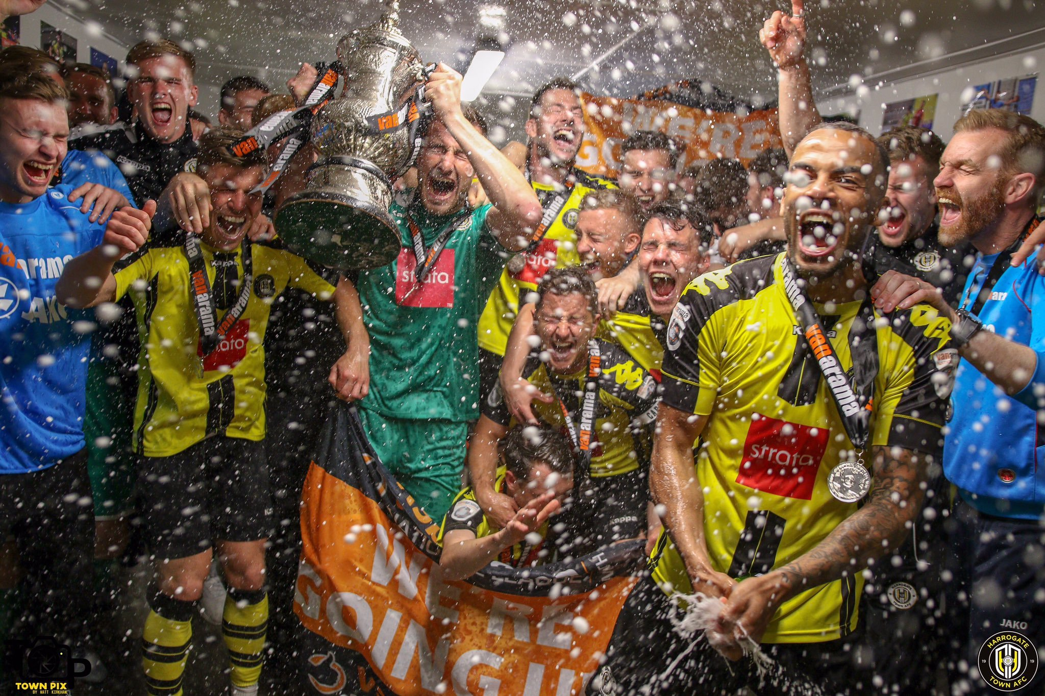 Harrogate Town celebrate their promotioin with champagne