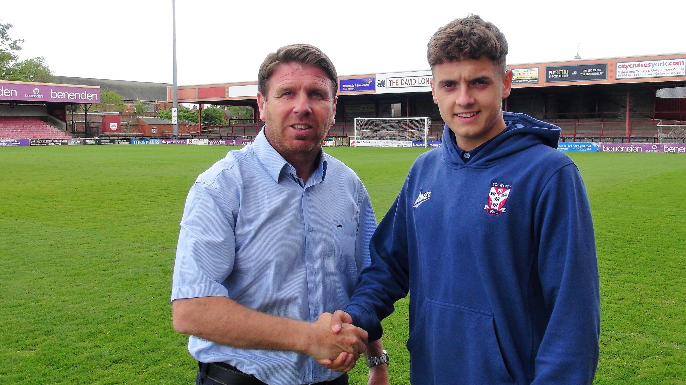 TURNING PRO: Harry Thompson (right) shakes on terms with York City boss Martin Gray