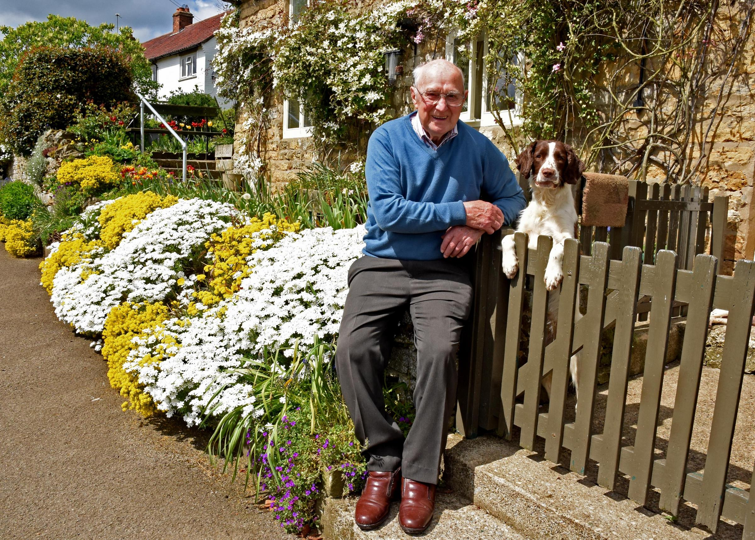 Bernard Simpson, pictured, with Rolo, in the village of Beadlam where he founded the village tractor run in 2003, which over the years has raised £102,000 for the Yorkshire Air Ambulance Picture: Nigel Holland