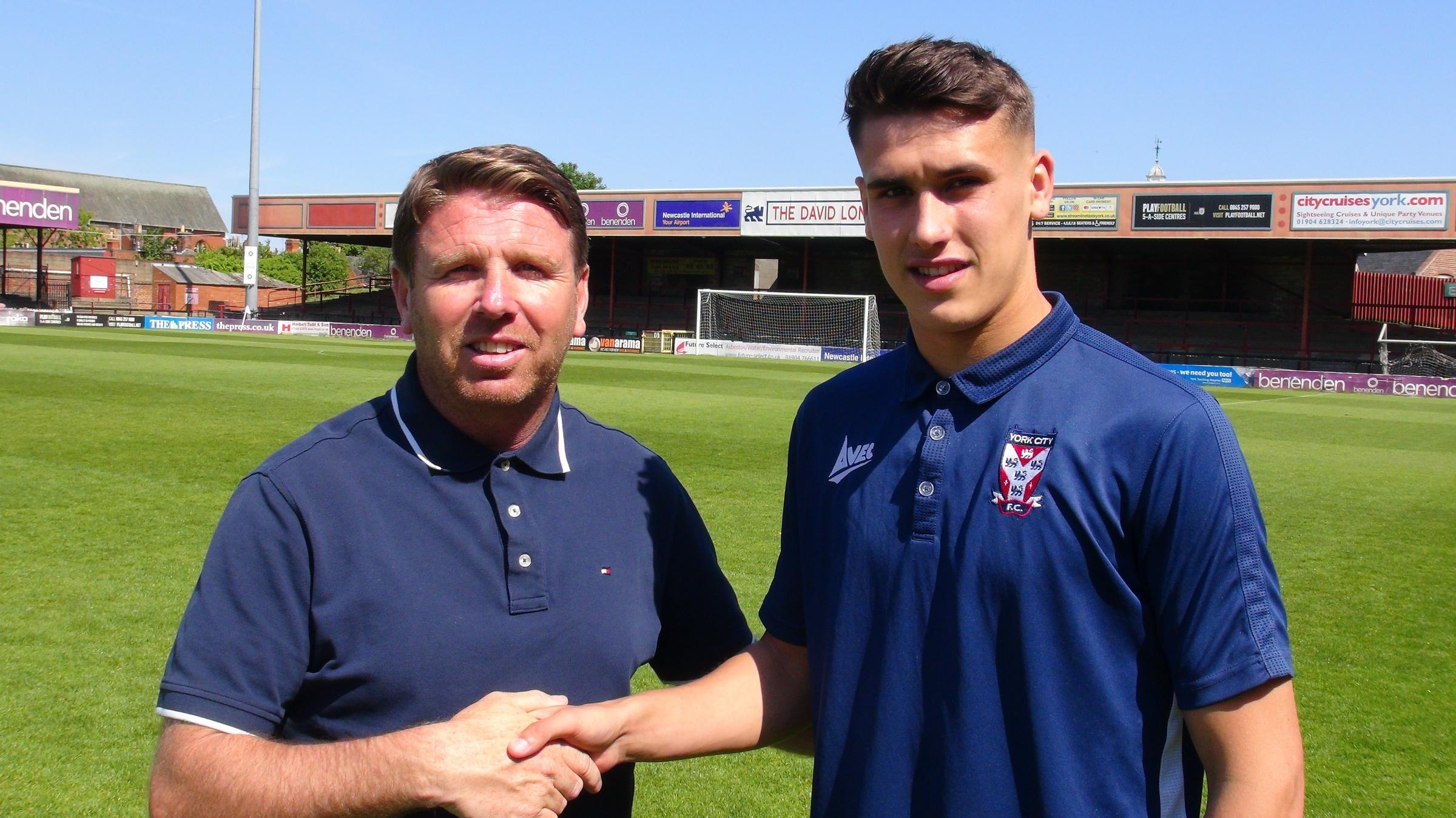 York City manager Martin Gray, left, welcomes centre-back Josh Rogerson to the professional ranks. Picture: Ian Appleyard/YCFC