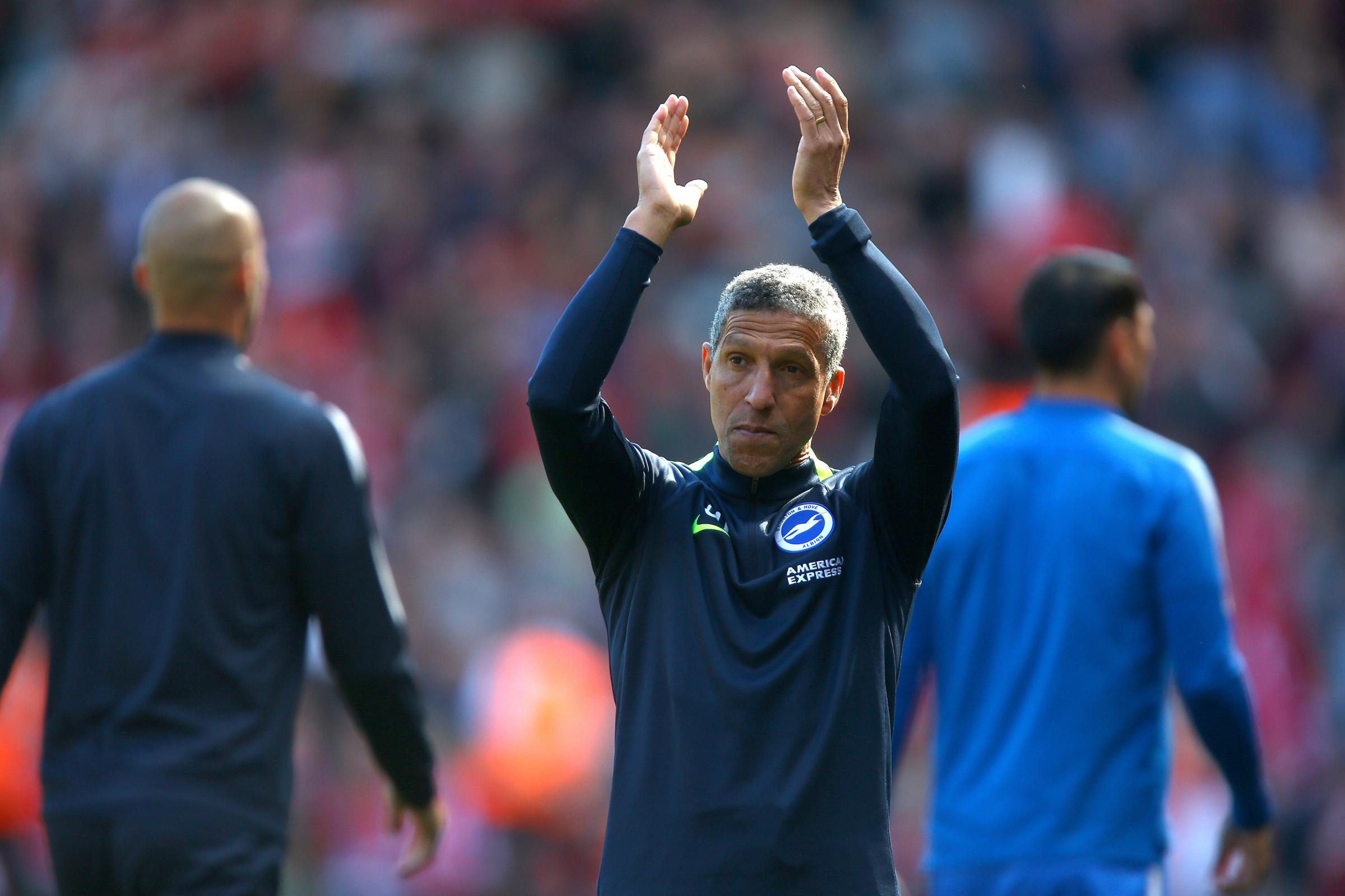 Brighton & Hove Albion manager Chris Hughton acknowledges the fans after the final whistle during the Premier League match at Anfield, Liverpool.