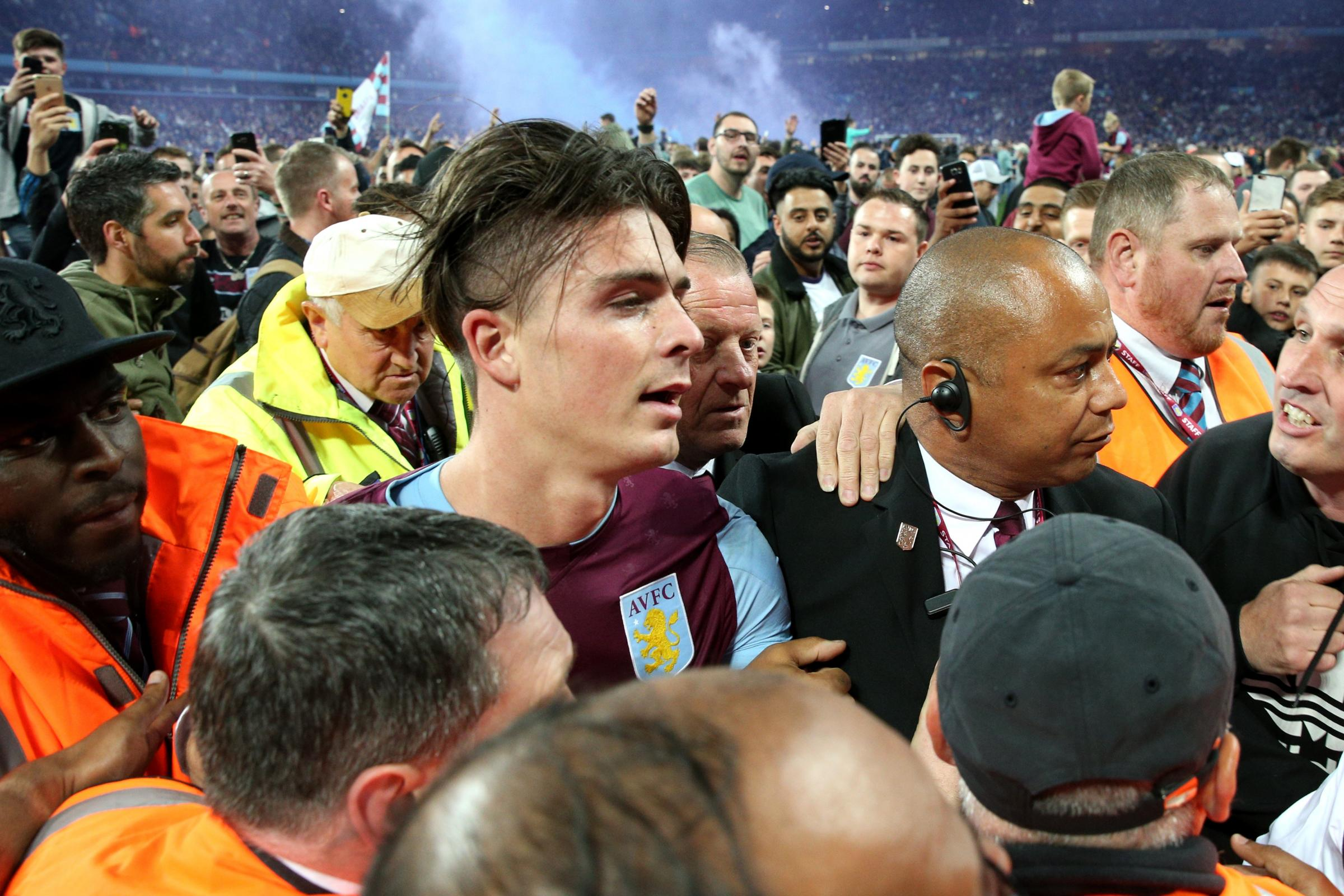 Aston Villa's Jack Grealish is mobbed after the final whistle against Middlesbrough (Martin Rickett/PA)