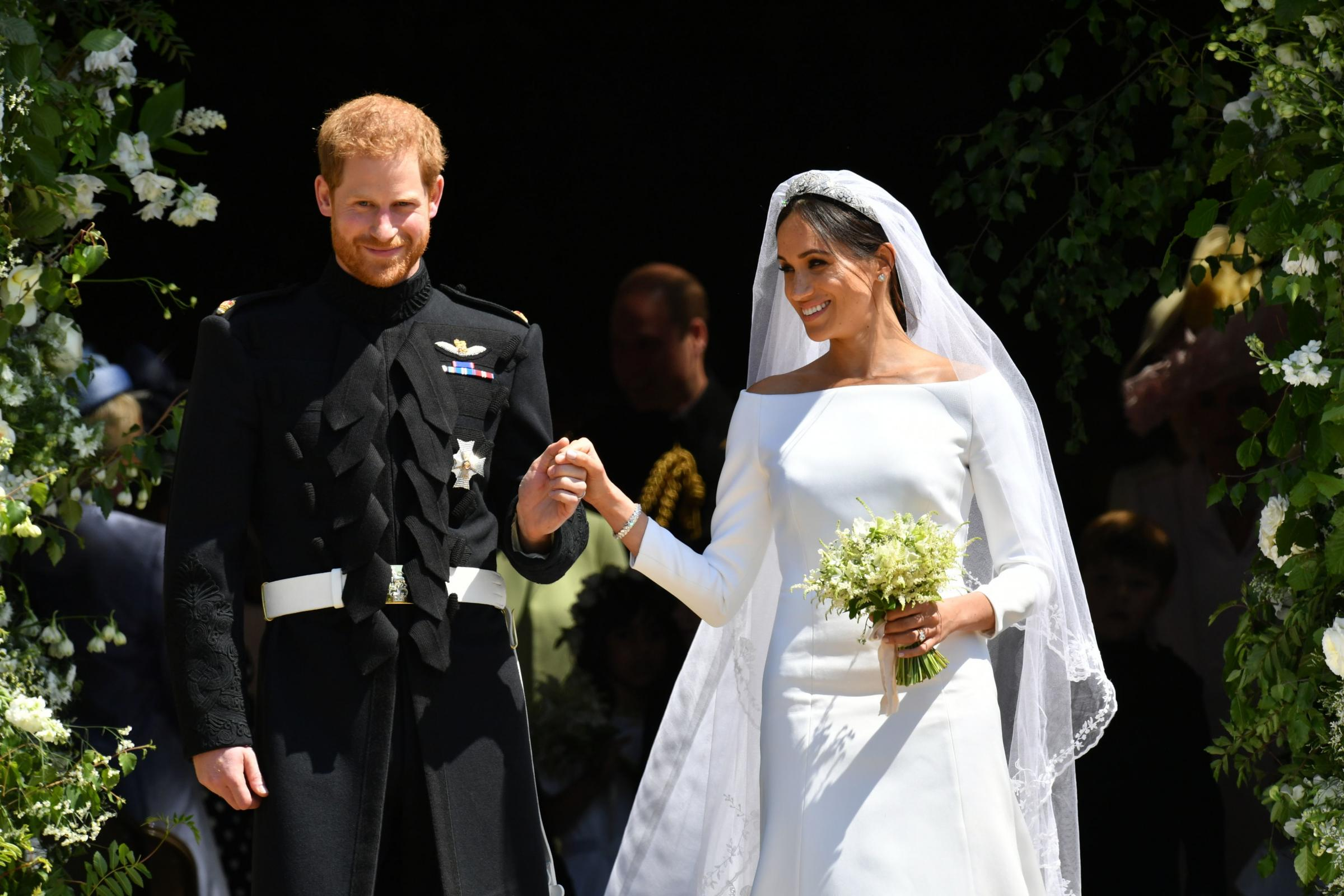 MARRIED  Harry, Duke of Sussex presents his bride, Meghan Duchess of Sussex to the world at the door of St George's Chapel
