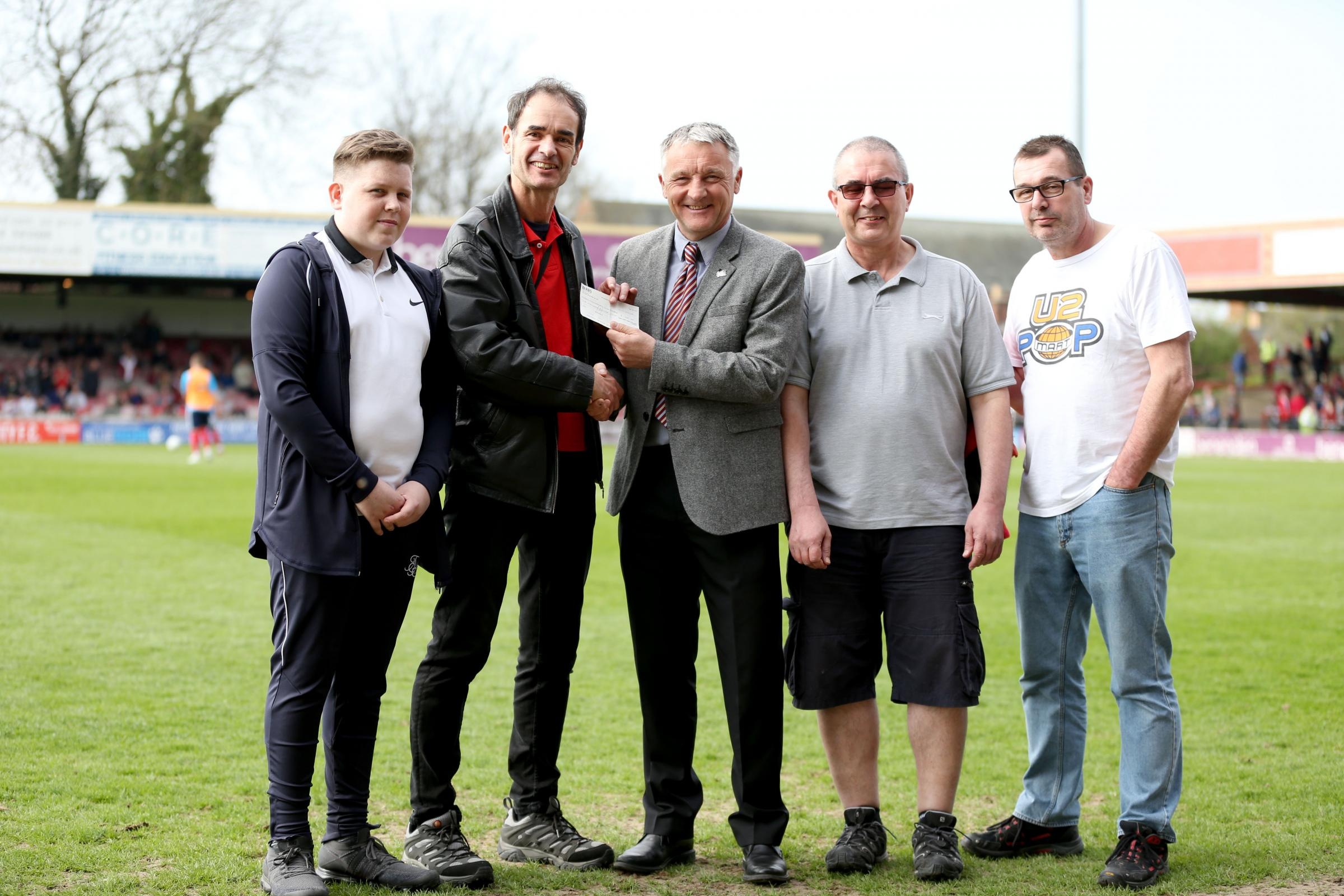FAMILY TIES: The family of former York City keeper Joe Berridge hand over a £1,000 cheque for the club's academy to sporting director Dave Penney. Pictured from left-to-right are: Euan Berridge, Martin Berridge, Penney, Graham Berridge and Kevin Berridge