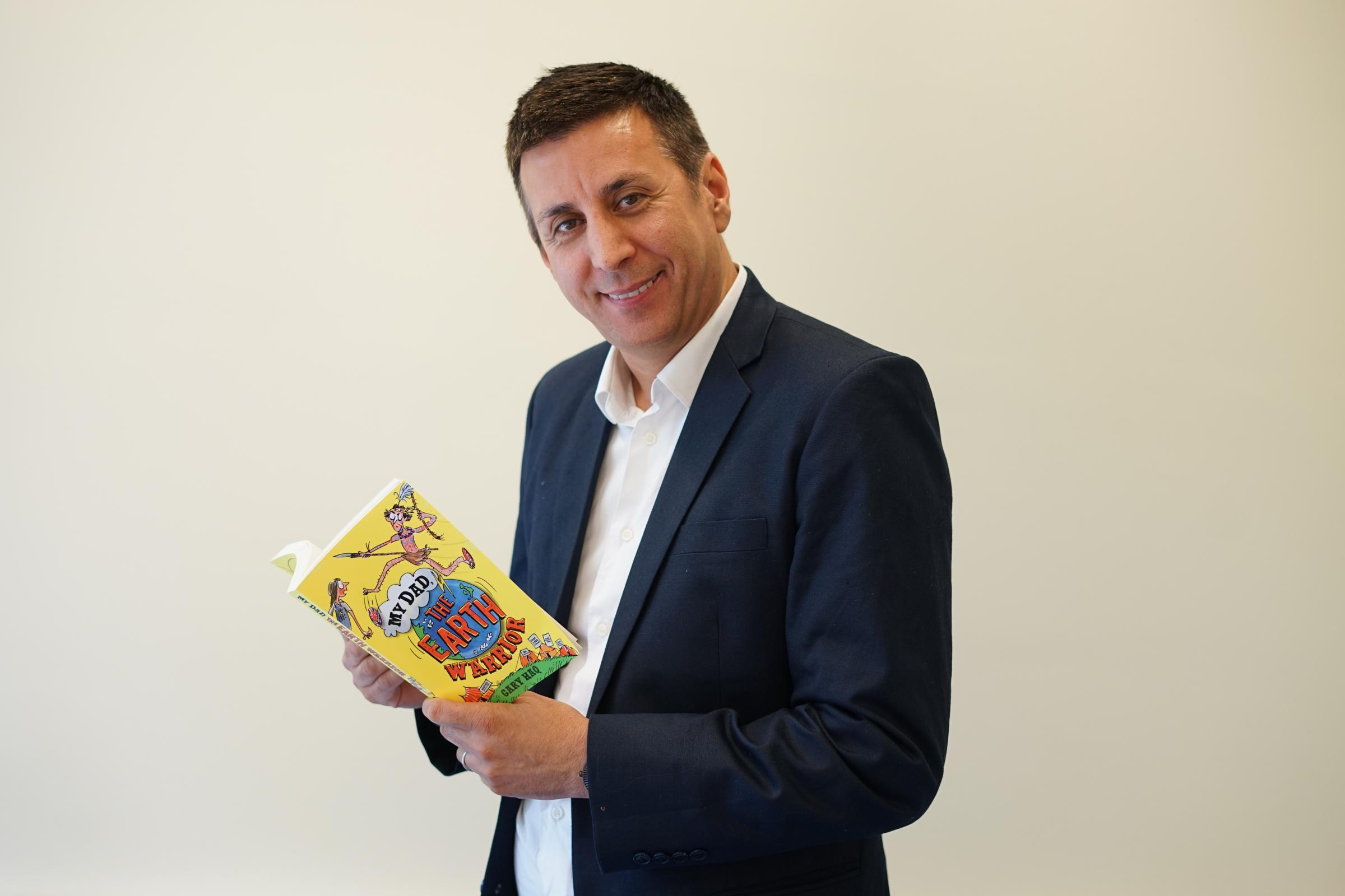 Gary Haq with his new children's book with an environmental message