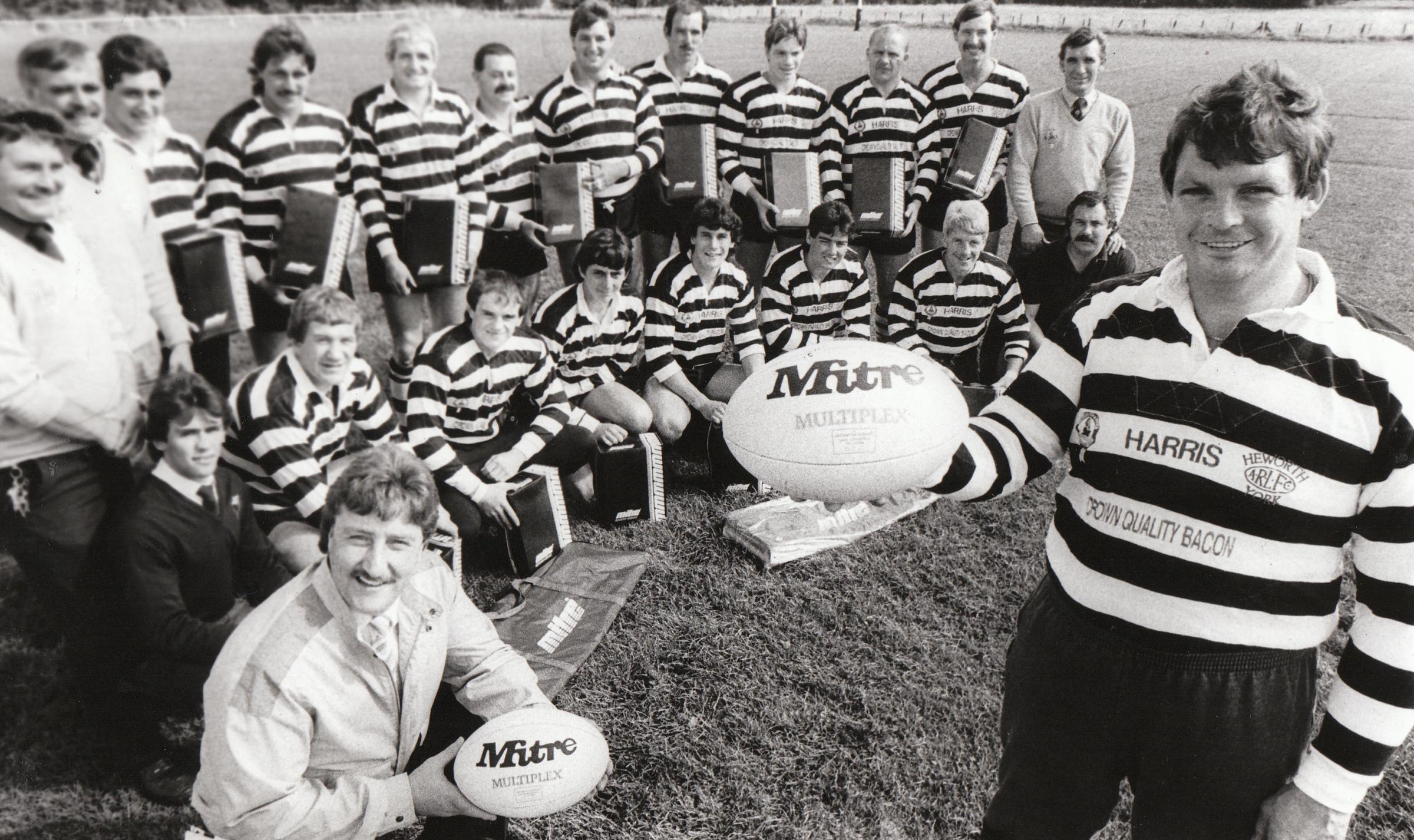 September 1987: Peter Deakin (kneeling, front left) of Open Rugby Magazine, presents Heworth ARLC coach Colin Forsyth (right) and his team with items of sportswear for winning the Mitre sponsored Open Rugby Team of the Season award the previous season