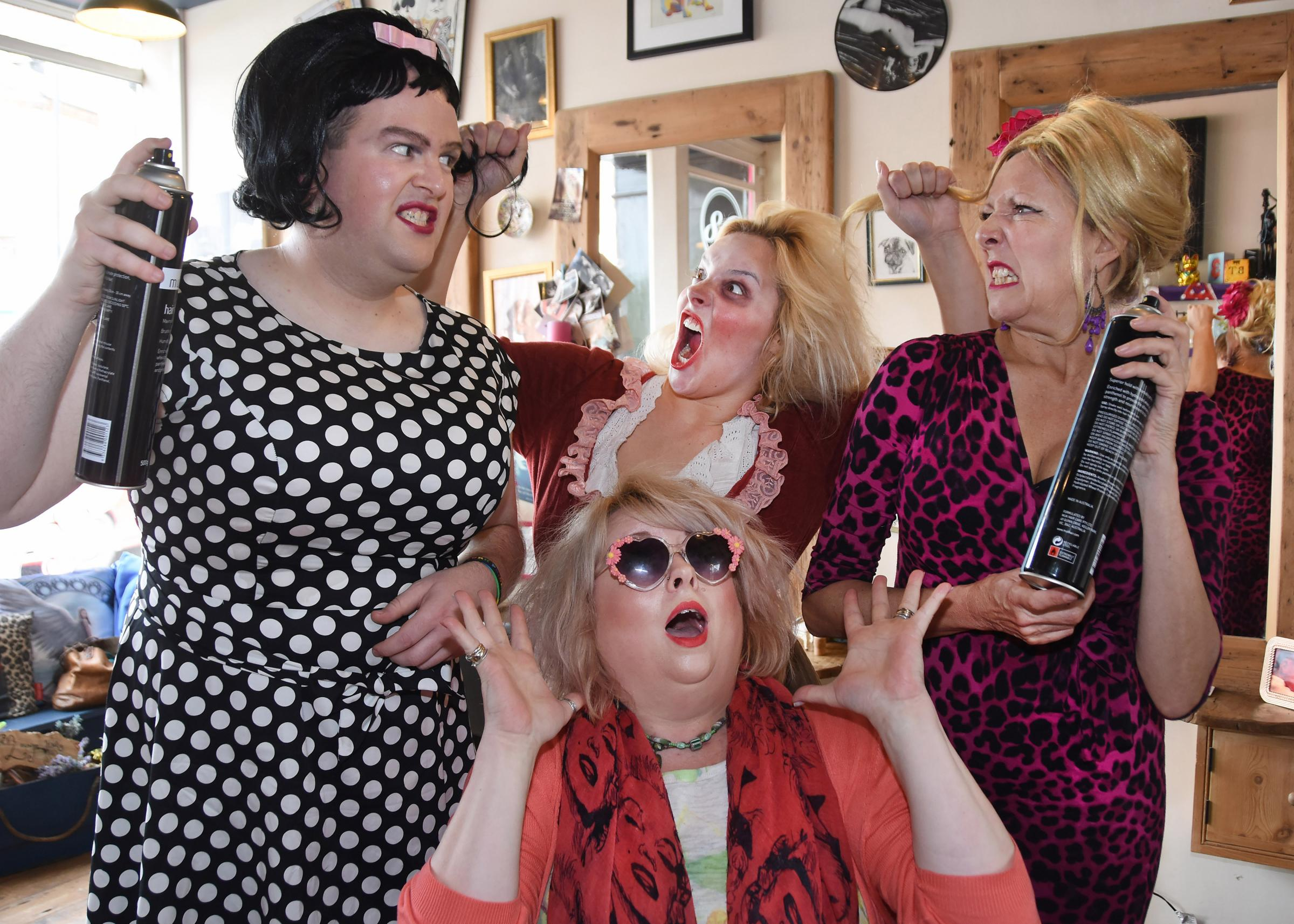 Hair-raising! David Rennie, as Hairspray's Edna Turnblad, left, Olivia Cole, as York Dungeon's Betty Turpin, and Rachel Alexander-Hill as Hairspray's Velma Von Tussle, with salon owner Louise Ndlovu at The Lounge, in Gillygate, York. Picture: