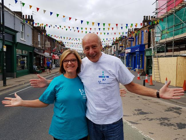 VENUE CHANGE: Julie Russell of York Against Cancer with Berwick Kaler in Bishopthorpe Road ahead of the R u Taking the P? race