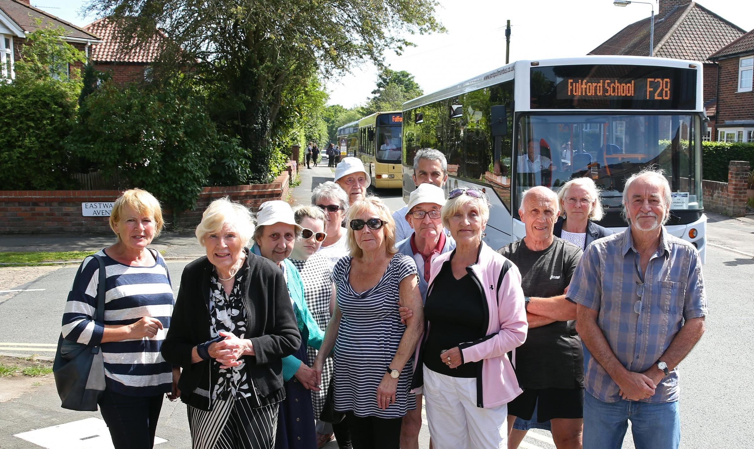 PROTEST: Residents watch school buses leaving Fulford School. Reader Ann Forshaw is not surprised they are angry at the sheer number of cars and buses. Picture: Richard Doughty