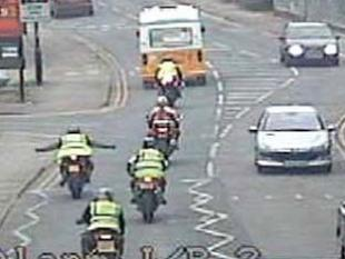 One of the men rides without holding the handlebars and is caught on CCTV