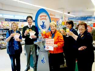 Richard Cann store manager of Sainsbury's in Tadcaster, and colleagues making a toast to congratulate the mystery ticket holder