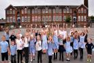 POSITIVE: Poppleton Road School pupils celebrate their Ofsted success with head teacher Debbie Glover, centre left, and deputy head teacher Ellie Dawson  Picture: Frank Dwyer
