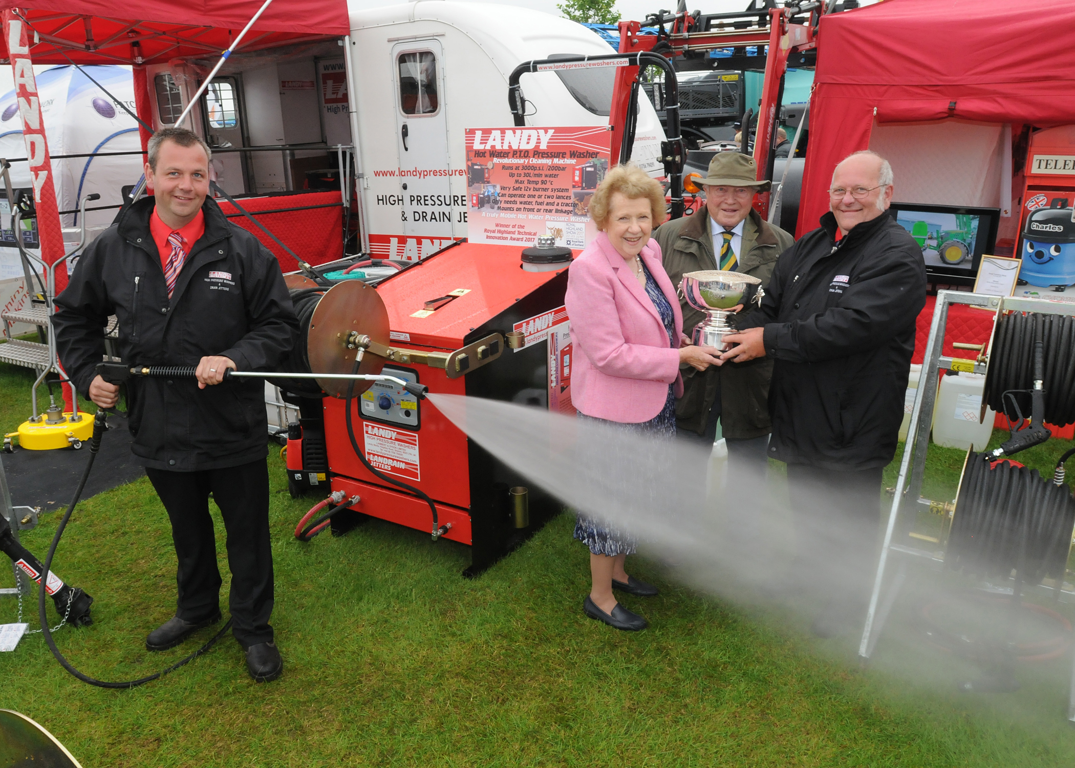 Picture shows Mr Matthew Lambert, Director of Landy Pressure Washers demonstrating their new washer system whilst (l to r) Mrs Jenny Penty and Mr John Penty present the White Rose What's Next Innovation Award to the Chairman of Landy Pressure Washers