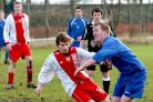 Copmanthorpe's Martin Bastock, left, slides in on Malton and Norton's Kevin Oxendale
