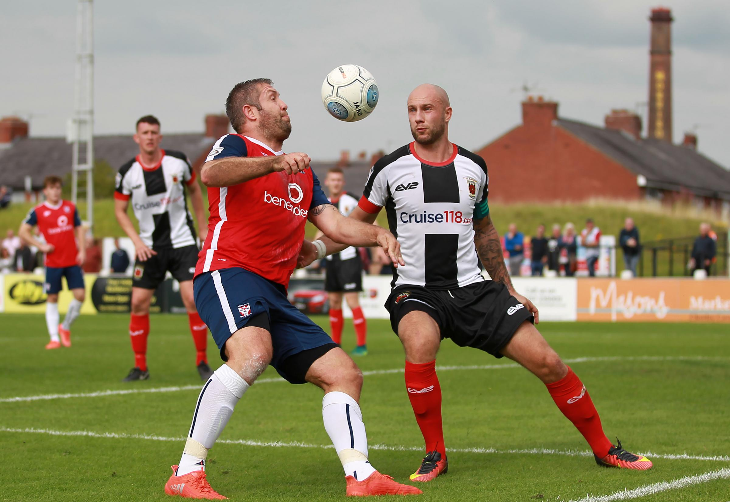 VICTORY QUEST: York City will visit Chorley's Victory Park on the opening day of the National League North season. Jon Parkin is pictured trying to get the better of Magpies captain Andy Teague in the corresponding fixture last September, which finish