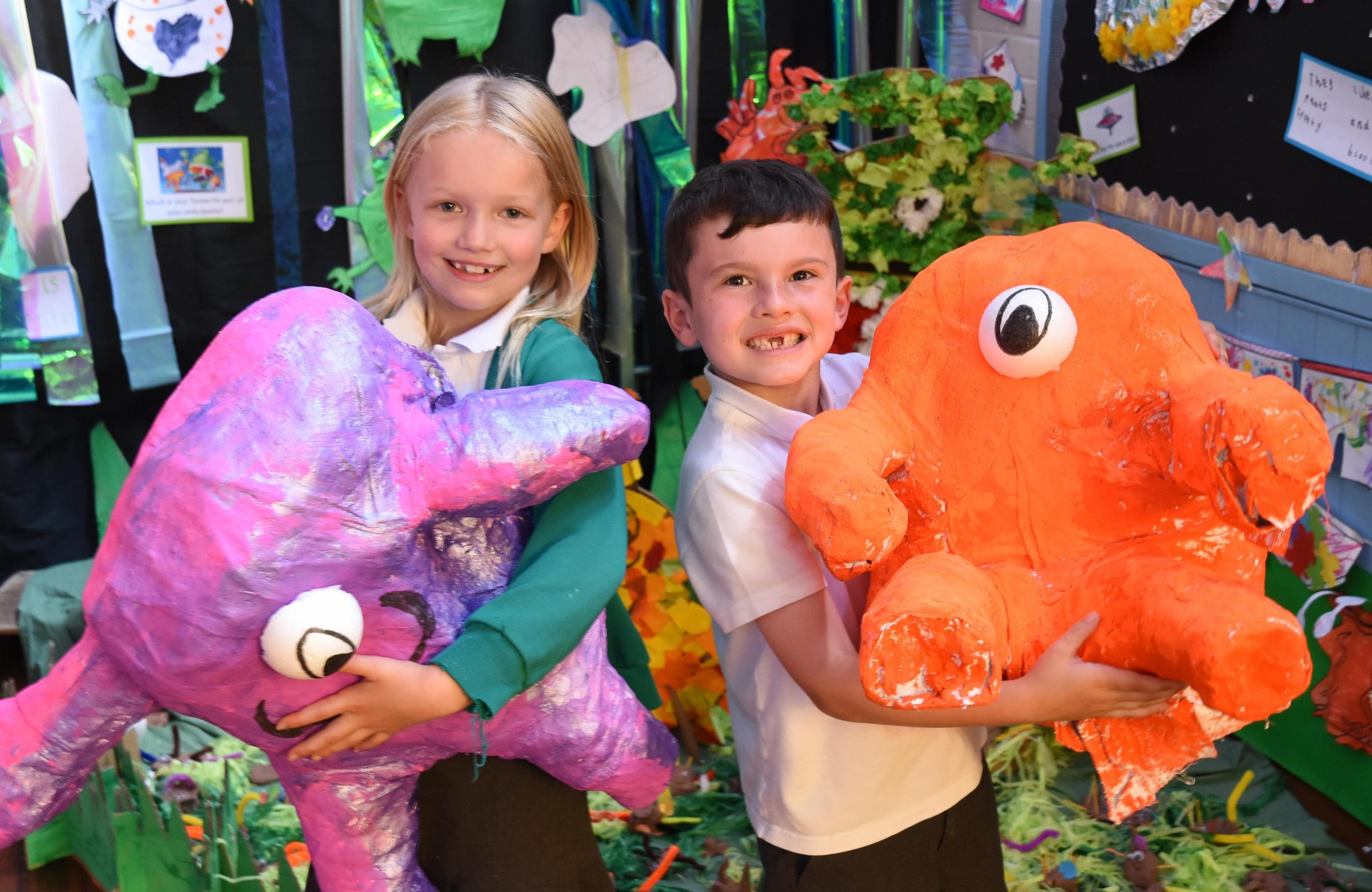 Phoebe Norton and Preston Coates holding models of aliens from their art show based on the book Aliens Love Underpants at Pickering Infant School      Picture: Nigel Holland