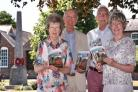REMEMBER: Villagers Prudence Bebb, Julian Crabb, Edward Kendall and Pamela Gittus with copies of their new book by the war memorials in Poppleton  Picture Frank Dwyer