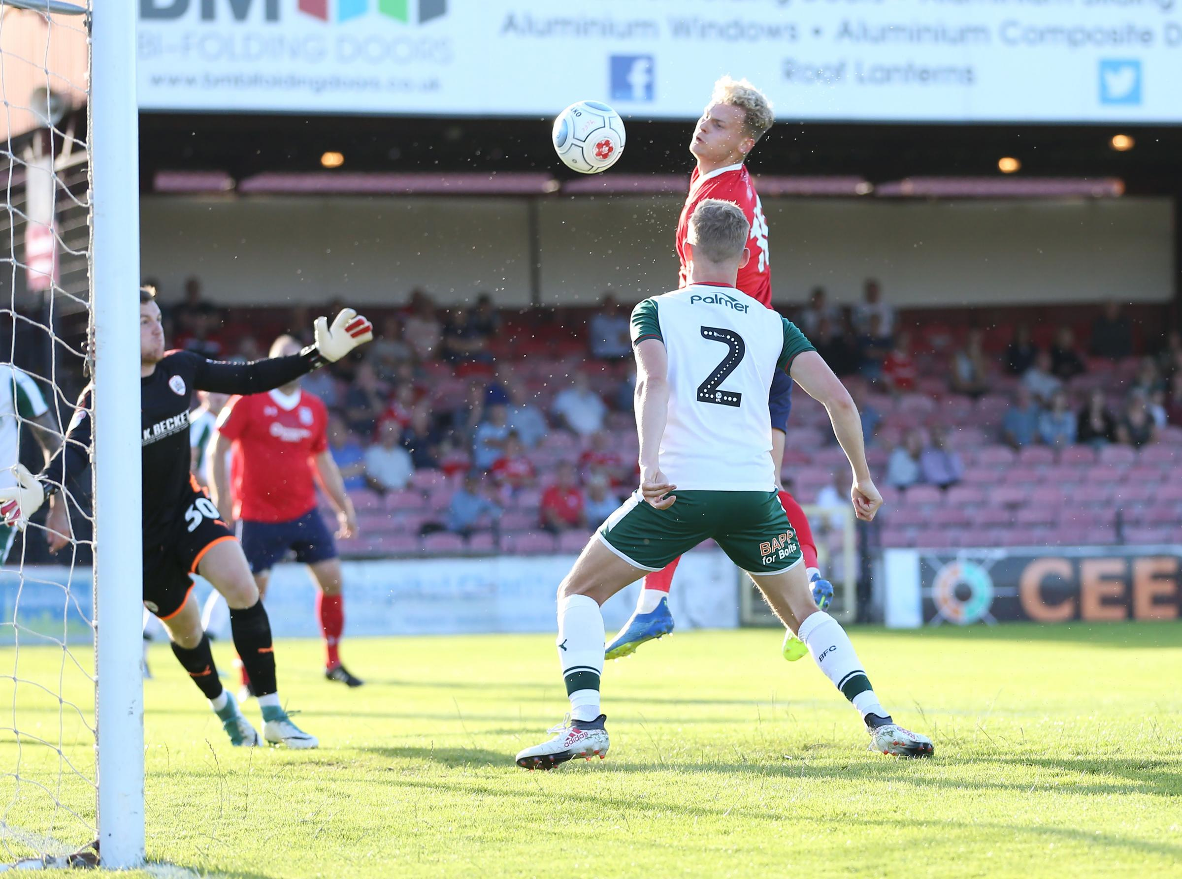 CHEST IN TIME: Jake Wright improvises to give York City the lead against Barnsley. Picture: Gordon Clayton