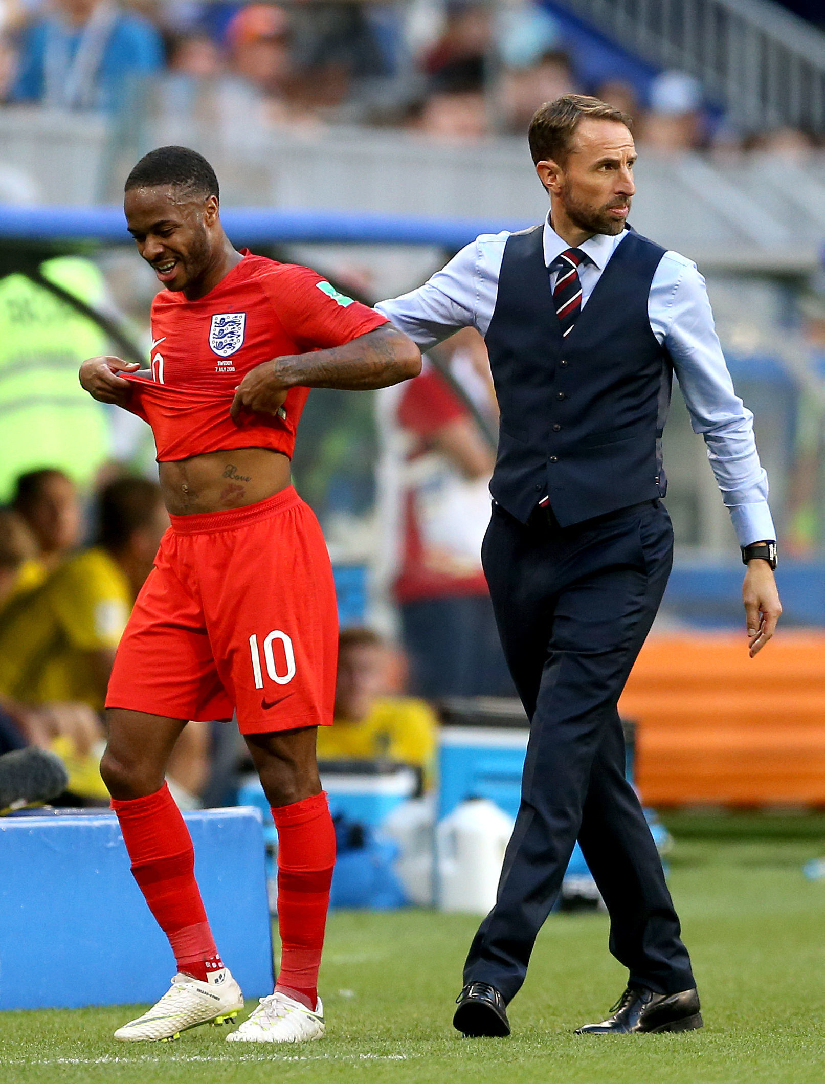 England's Raheem Sterling (left) with Three Lions' boss Gareth Southgate